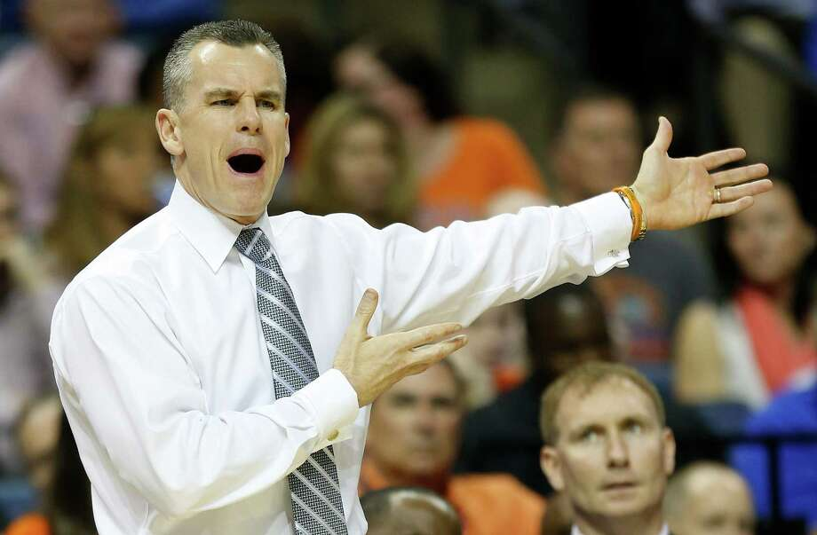Donovan back as a coach: Billy Donovan's return to the Final Four as the Gators' coach will keep the total at six who have coached and played at a Final Four. The others are Vic Bubas, Dick Harp, Bob Knight, Bones McKinney and Dean Smith. Donovan, speaks to his players against UCLA during the first half in a regional semifinal game at the NCAA college basketball tournament, Thursday, March 27, 2014, in Memphis, Tenn. Photo: John Bazemore, Associated Press / AP