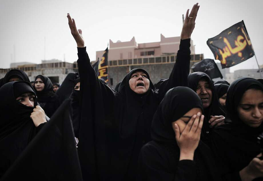 Bahraini women mourn the death of Hussein Ahmed Sharaf, a Bahraini man who was in hiding having earlier been sentenced to life in prison in absentia, after he died in an explosion at his home two days ago, during his funeral procession on April 3, 2014, in the village of Al-Akr, south of the capital Manama. TOPSHOTS/AFP PHOTO/MOHAMMED AL-SHAIKHMOHAMMED AL-SHAIKH/AFP/Getty Images Photo: Mohammed Al-shaikh, AFP/Getty Images