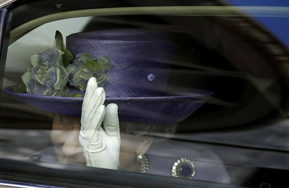 Britain's Queen Elizabeth waves to Pope Francis at the end of their meeting at the Vatican, Thursday, April 3, 2014. Queen Elizabeth II has come to Rome for lunch with Italy's president Giorgio Napolitano  ahead of the British monarch's first meeting with Pope Francis. Before Francis, Elizabeth had met with four pontiffs, starting with Pope Pius XII in 1951, a year before her accession to the throne. (AP Photo/Gregorio Borgia) Photo: Gregorio Borgia, Associated Press