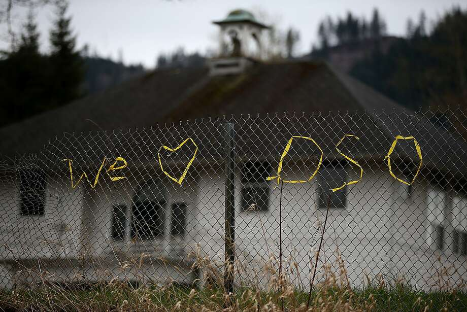 OSO, WA - APRIL 03:  A message in support of the town of Oso is written on a fence with yellow ribbon on April 3, 2014 in Oso, Washington.  Workers continue to sift through debris trying to locate missing people almost two weeks after a massive mudslide devastated the town, killing at least 30 people and leaving many missing.  (Photo by Justin Sullivan/Getty Images) Photo: Justin Sullivan, Getty Images