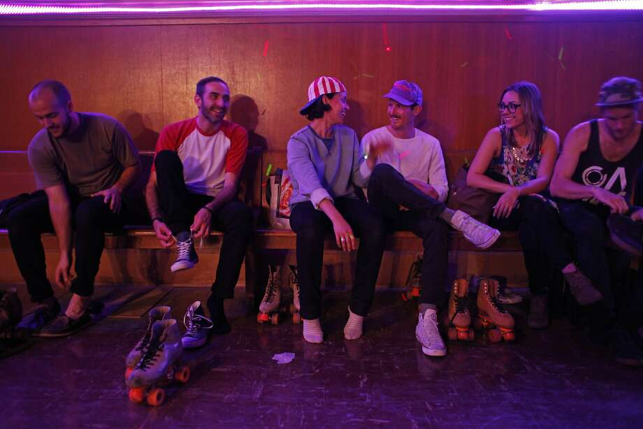 Skaters change back into their shoes after a night of skating at the Church of 8 Wheels on Fillmore Street on March 19, 2014 in San Francisco, Calif. The Church of 8 Wheels is the brainchild of David Miles, Jr. and features roller skating several nights a week in a disused church at 554 Fillmore Street. Photo: Pete Kiehart, The Chronicle