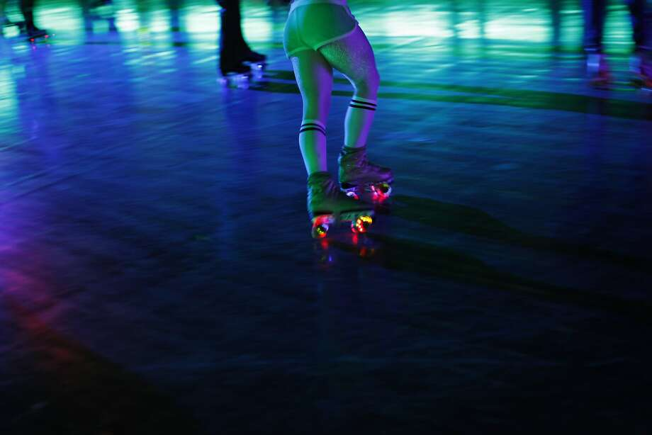 A skater's wheels light up at the Church of 8 Wheels in S.F. The rink is inside a former church. Photo: Pete Kiehart, The Chronicle