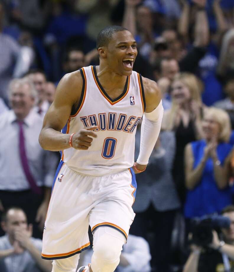 Oklahoma City Thunder guard Russell Westbrook (0) runs up the court in the fourth quarter of an NBA basketball game following a basket against the San Antonio Spurs in Oklahoma City, Thursday, April 3, 2014. Oklahoma City won 106-94. (AP Photo/Sue Ogrocki) Photo: Associated Press