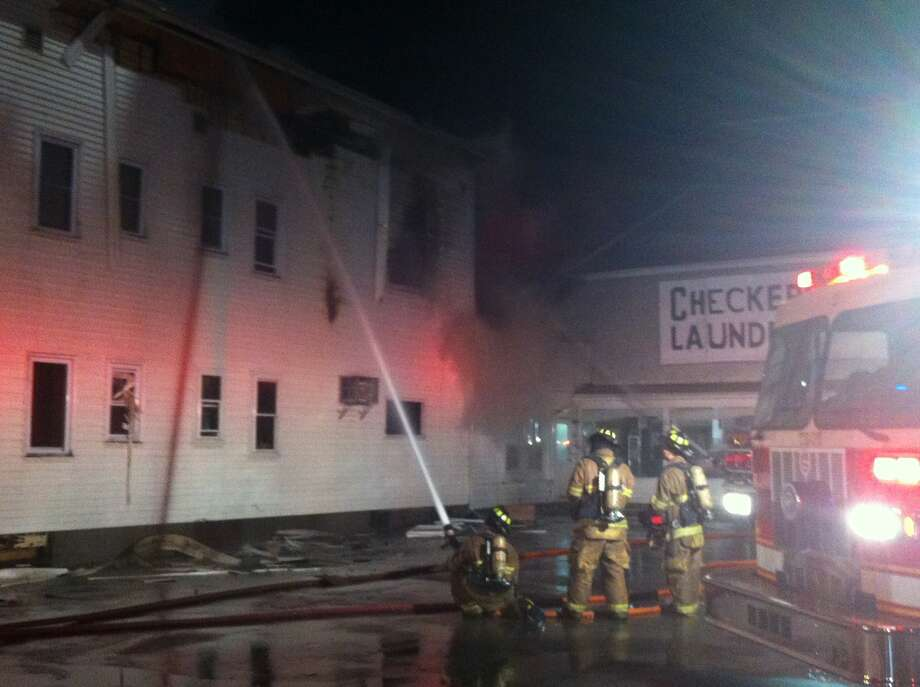 Firefighters battle a blaze on Fifth Avenue in Lansingburgh. Photo: Ken Crowe/Times Union