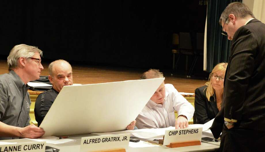 At a late hour during Thursday's Planning and Zoning Commission meeting, confusion arose as some members questioned whether the proposed relocation of the Kemper Gunn House was clearly delineated on a map. Photo: Jarret Liotta / Westport News