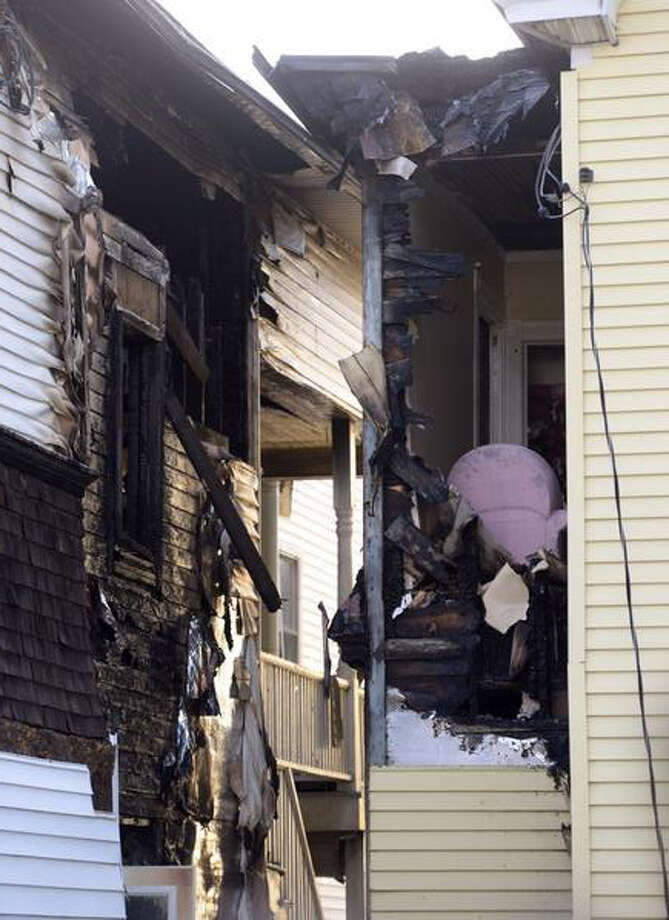 Two buildings in the Lansingburgh section of Troy were damaged in a fire overnight. (Skip Dickstein / Times Union)