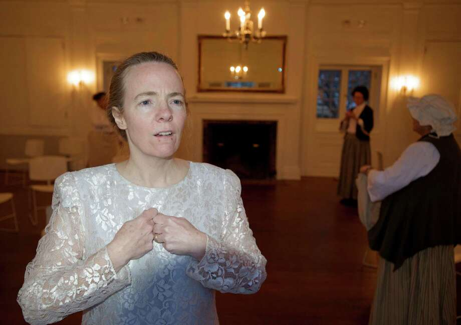 """Mary Beth Bass, of Danbury, during a rehearsal for the short play """"Women in the Shadows"""", on Thursday, April 4, 2014. The play is being presented by the Keeler Tavern Museum, in Ridgefield, Conn, as part of """"Tea with the Ladies of Keeler Tavern - a conversation across generations"""", on Sunday, April 6th, in the Garden House. Tickets are $40 for museum members and $45 for non-members.  Bass portrays Julia Finch Gilbert, behind her, from left, are Dawn Berenson, of South Salem, New York, who portrays Phillis Dubois, Paula Curry, of Ridgefield, who portrays Anna Marie Resseguie and Sue Seifer, of Ridgefield,who portrays Esther Keeler. The play brings to life five of the women who called the historic Keeler Tavern home. Not in photo is Diane Costello, who portrays Anna Keeler Resseguie. Photo: H John Voorhees III / The News-Times Freelance"""