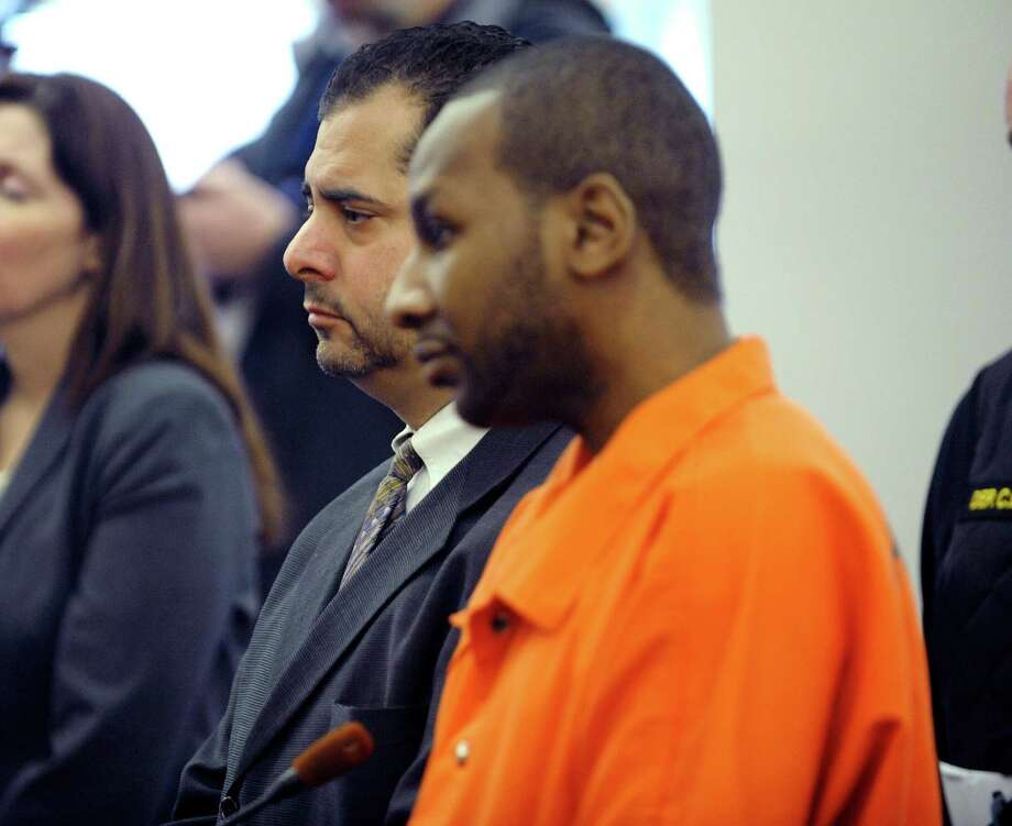 Michael Anderson, right, standing next to his attorney Michael Jurena, left, addresses the court at the Albany County Judicial Center during his sentencing on Monday, March 3, 2014 in Albany, NY.  Anderson was supposed to be sentenced for killing his ex-girlfriend's sister, Tonette Thomas.  The sentencing was delayed because Anderson asked to withdraw his guilty plea and also asked for a new lawyer.  Far left is Albany County Assistant District Attorney Shannon Sarfoh.  (Paul Buckowski / Times Union) ORG XMIT: MER2014030310563938 Photo: Paul Buckowski / 00025966A