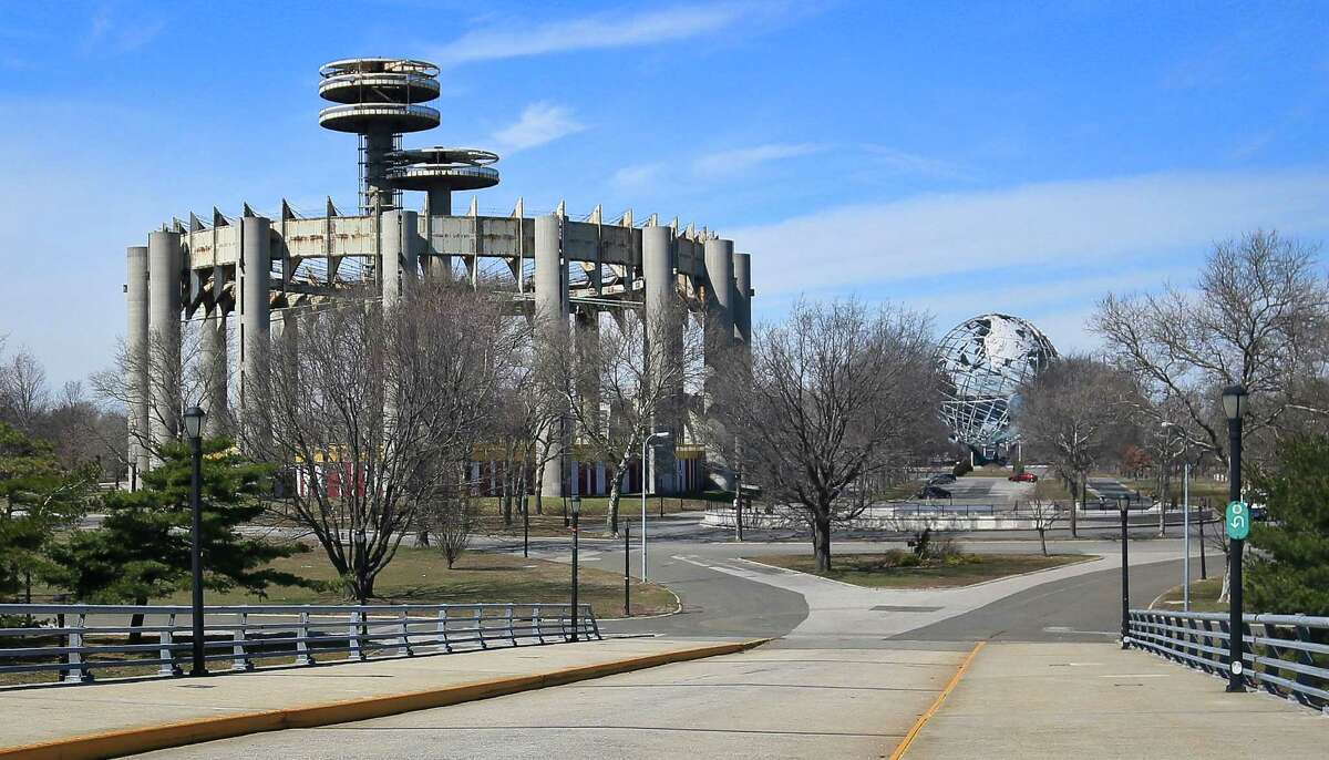 A space-age tower, left, and a restored giant metal globe called the Unisphere, remain as original structures from the 1964 World's Fair, Tuesday April 1, 2014 in the Queens borough of New York. A group of preservationists is fighting to save the towers and a pavilion of pillars once called the