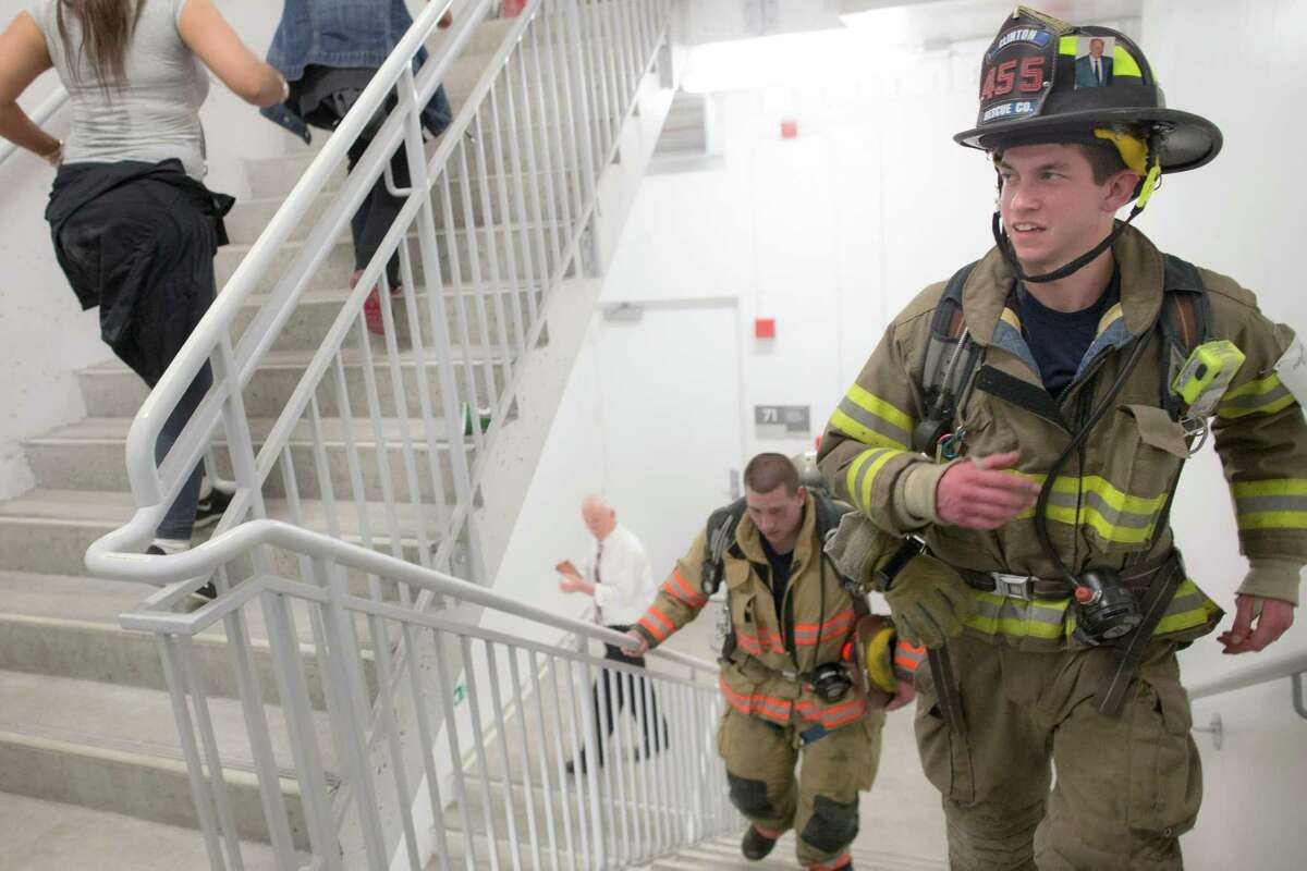 Firefighters from departments outside New York climb towards the 72nd floor of 4 World Trade Center during the