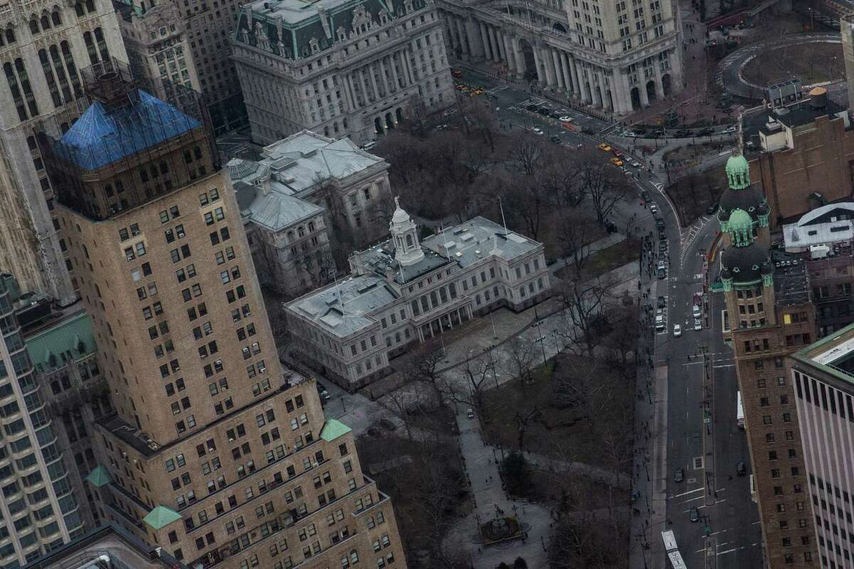 """NEW YORK, NY - APRIL 03: New York City Hall is seen from Four World Trade Center during the """"Runyon Up,"""" a stair race in which participants run up 72 floors of stairs inside the Four World Trade Center building on April 3, 2014 in New York City. The race attracted hundreds of participants, with the winner finishing in under 10 minutes. The run raised money and awareness for cancer research. (Photo by Andrew Burton/Getty Images) ORG XMIT: 482431861"""