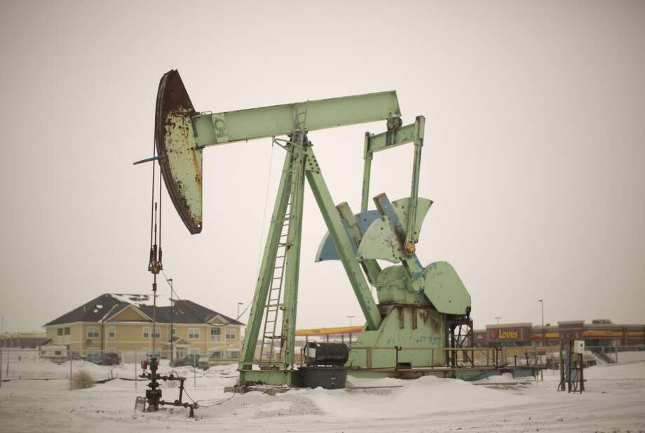 Work in the Bakken Oil Fields of North Dakota has brought an influx of thousands or workers, making North Dakota the fastest growing state in America. Photo: Jeff Wheeler, McClatchy-Tribune News Service