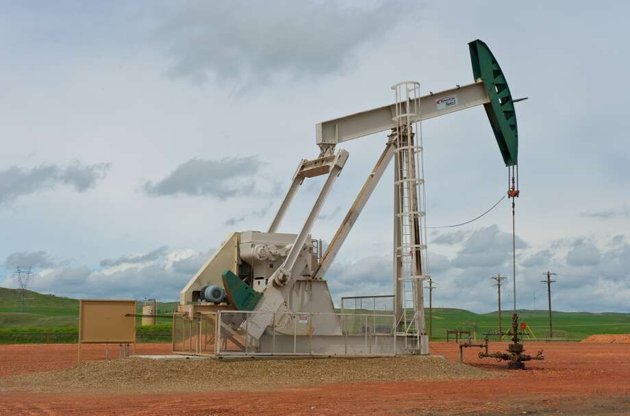 A pumpjack works on a ConocoPhillips project in the Bakken shale, a prolific oil region that stretches across parts of North Dakota and Montana. Photo: ConocoPhillips