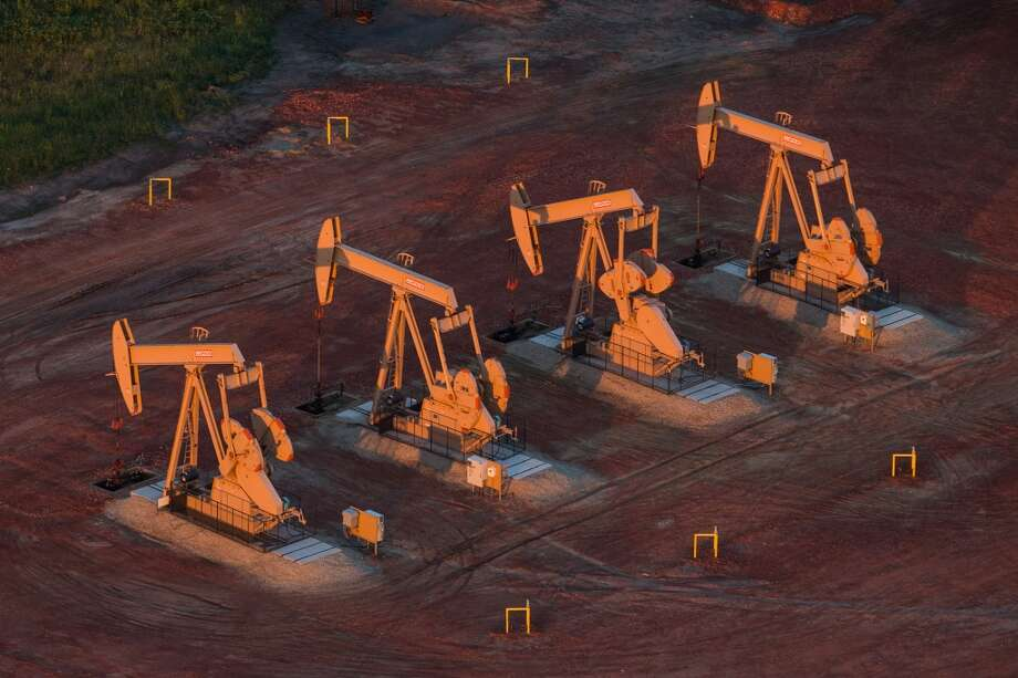 Pumpjacks are seen in an early morning in 2013 near Watford City, North Dakota. North Dakota has seen a boom in oil production thanks to new drilling techniques including horizontal drilling and hydraulic fracturing. Photo: Andrew Burton, Getty Images