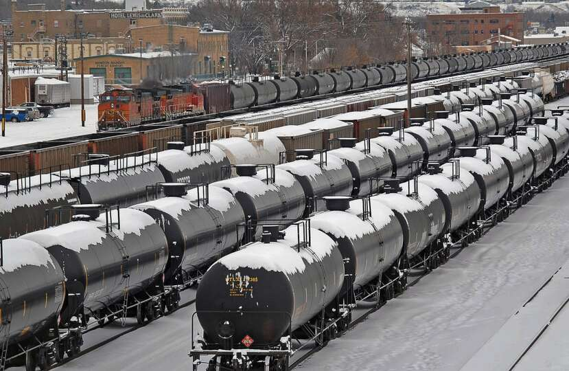 Oil rail cars are backed up in the yard in the aftermath of a train derailment in December 2013 in M