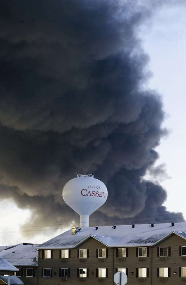 A fireball goes up at the site of an oil train derailment in Casselton, N.D. in December 2013. Federal investigators determined that 400,000 gallons of oil was lost in the derailment. Photo: Bruce Crummy, Associated Press
