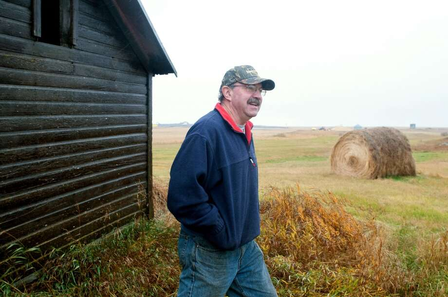 Steve Jensen stands near the site of an oil spill he discovered outside of Tioga, N.D. in October 2013. Officials took nearly two weeks to tell the public about the break in a Tesoro Corp. pipeline that happened in a remote area of North Dakota. Officials say no water was contaminated and no wildlife was hurt. Jensen was harvesting wheat when an oil pipeline leak was discovered. Photo: Kevin Cederstrom, Associated Press