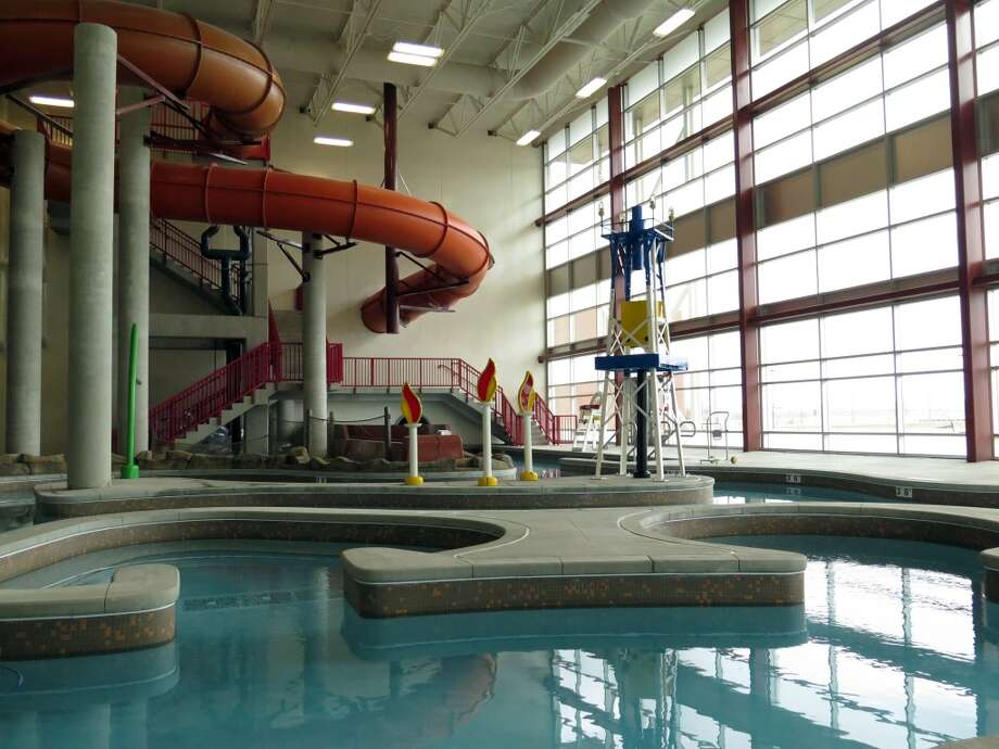 An oil derrick and the flames of gas fires decorate an indoor water park at a new recreation center in oil-rich Williston, North Dakota. The city hopes the center will help draw families to North Dakota's oil patch. Photo: Josh Wood, Associated Press