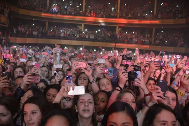 NEW YORK, NY - MARCH 05:  Female audience during Austin Mahone concert at Hammerstein Ballroom on March 5, 2014 in New York, New York.  (Photo by Theo Wargo/Getty Images)