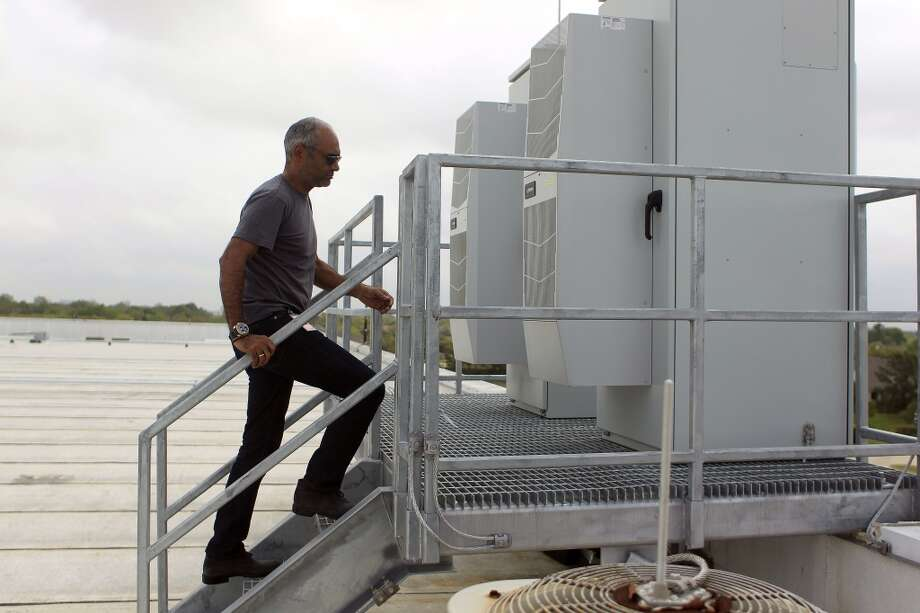 Kanojia founder and CEO of Aereo Inc. walks up to one of two cabinets where Aereo's  antennas receive television signals. Photo: Johnny Hanson, Houston Chronicle