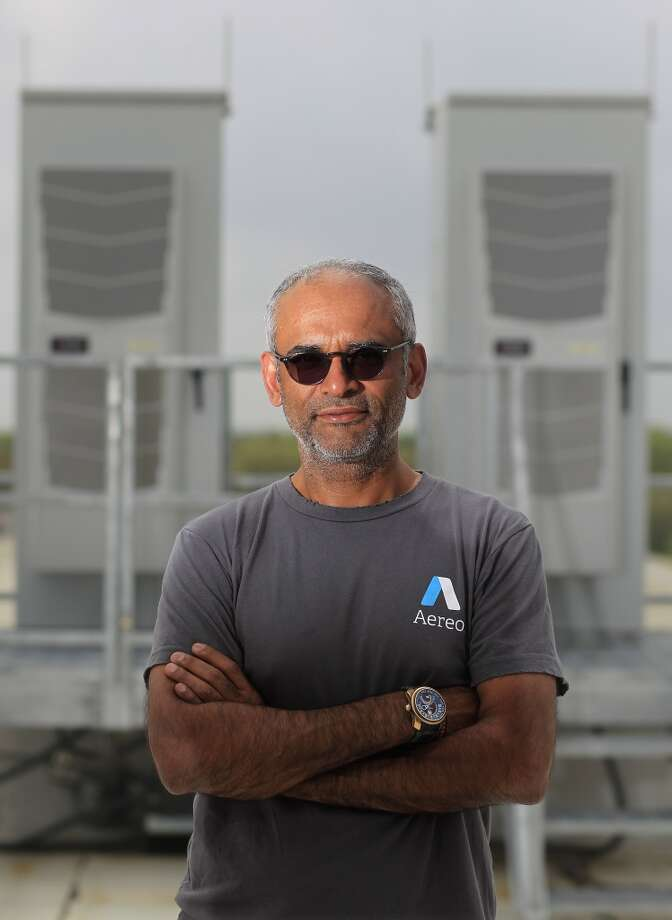 """Kanojia says the back side of the cabinets have coverings that are """"invisible"""" to TV signals. The data center location - which is kept secret - was picked partly because it gets good TV signals from area stations. Photo: Johnny Hanson, Houston Chronicle"""