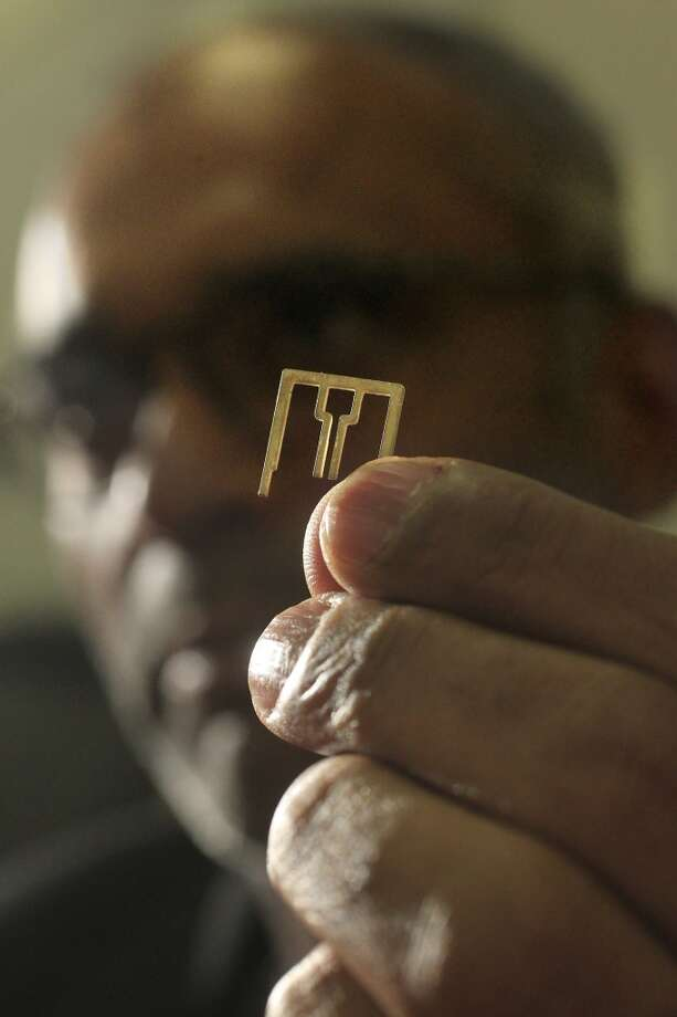 The small antennas are made of copper and coated in silver, bent into an M shape. Photo: Johnny Hanson, Houston Chronicle