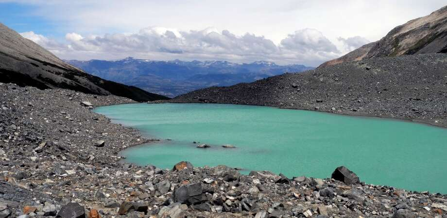 A turquoise lake fed by glaciers rests atop Cerro Castillo in Northern Patagonia in this January 2014 photo Photo: Brian Chasnoff, San Antonio Express-News