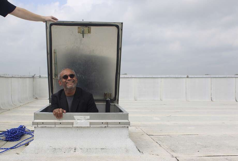"Chaitanya ""Chet"" Kanojia, founder and CEO of Aereo Inc., enters the roof of a data center where Aereo has antennas that receive television signals, which are converted into a video signal and streamed over the Internet. Photo: Johnny Hanson, Houston Chronicle"