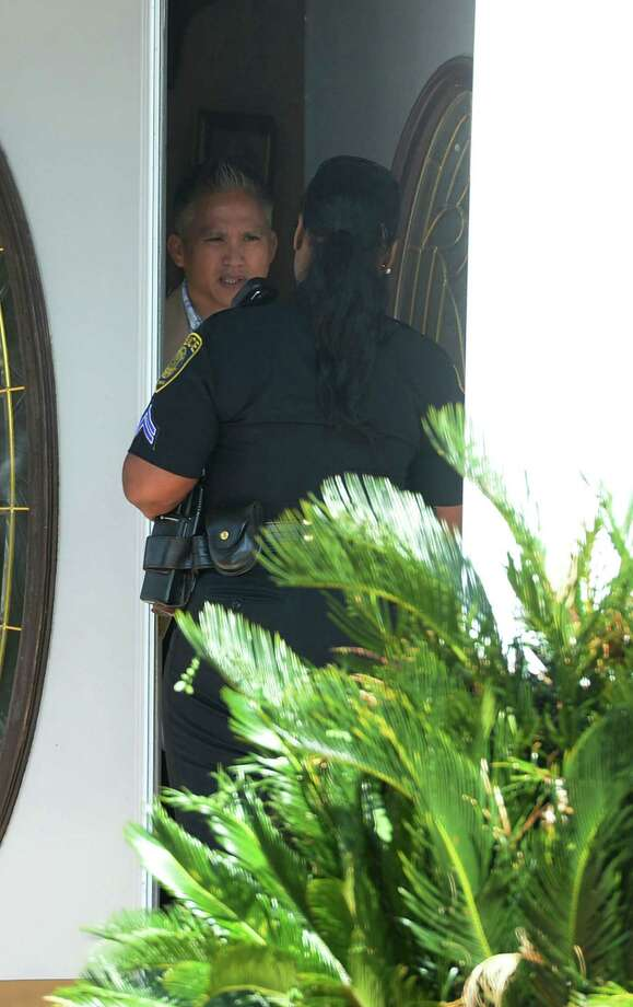 The FBI, Friday morning, searched the homes of Naomi Lawrence Lee BISD's purchasing director and William 'Bo' Kelley the former West Brook Booster Club president. A BISD officer is seen talking to someone in Lee's home. Photo taken Friday, April 04, 2014 Guiseppe Barranco/@spotnewsshooter Photo: Guiseppe Barranco, Photo Editor