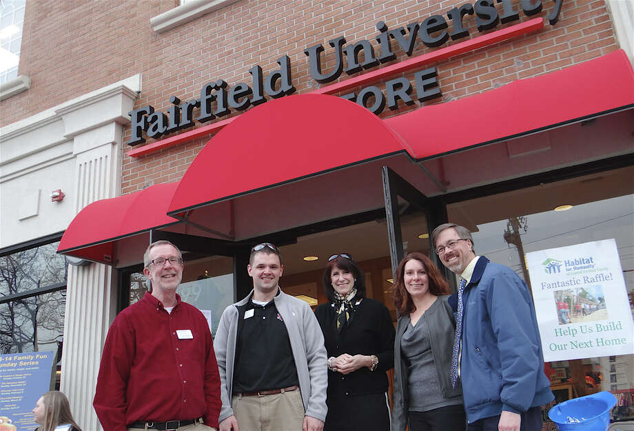 Fairfield University Bookstore's Craig Kennedy and Patrick McKiernan, at left, with Chamber of Commerce Executive Director Beverly Balaz and Kate and Mark Barnhart during downtown Fairfield's Spring Shop & Stroll event Thursday evening. Photo: Mike Lauterborn / Fairfield Citizen