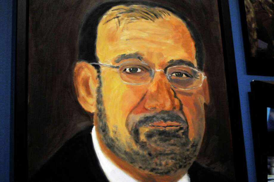 "A portrait of Iraqi Prime Minister Nouri al-Maliki which is part of the exhibit ""The Art of Leadership: A President's  Diplomacy,"" is on display at the George W. Bush Presidential Library and Museum in Dallas, Friday, April 4, 2014. The exhibit of world leaders painted by former President George W. Bush opens Saturday and runs through June 3. Photo: Benny Snyder, AP / AP"