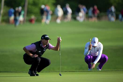 Sergio Castro, of Spain, right, and Steve Stricker, left, of Wisconsin study the 11th hole on the putting green during the second round of the Shell Houston Open at the Golf Club of Houston, Friday, April 4, 2014, in Humble. Photo: Marie D. De Jesus, Houston Chronicle / © 2014 Houston Chronicle