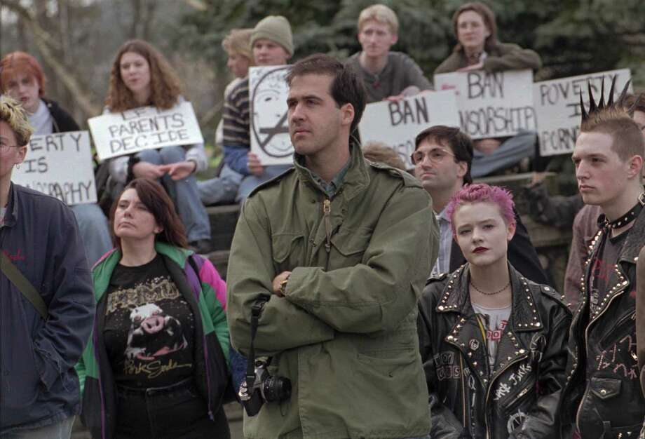 Since Cobain's death and Nirvana's disbandment, Krist Novoselic has been involved in political and social activism.Here, he listens to a speaker Feb. 22, 1995, at a rally on the Capitol steps in Olympia before addressing the crowd of demonstrators gathered to protest two bills that propose to censor music, concerts, film, literature and art. Photo: LOUIE BALUKOFF, AP / AP