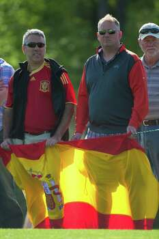 Manny Aragon, left, and Roberto Coogan show their support to Spaniard golfer Sergio Garcia during the second round of the Shell Houston Open at the Golf Club of Houston. Friday, April 4, 2014, in Humble. Photo: Marie D. De Jesus, Houston Chronicle / © 2014 Houston Chronicle