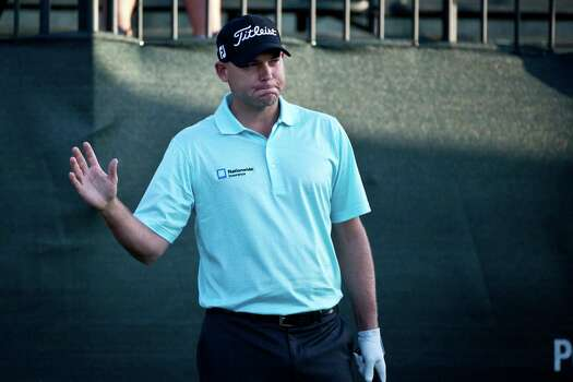 Bill Haas of South Carolina greets the audience on the first hole before teeing off on round two of the Shell Houston Open at the Golf Club of Houston, Friday, April 4, 2014, in Humble. Photo: Marie D. De Jesus, Houston Chronicle / © 2014 Houston Chronicle