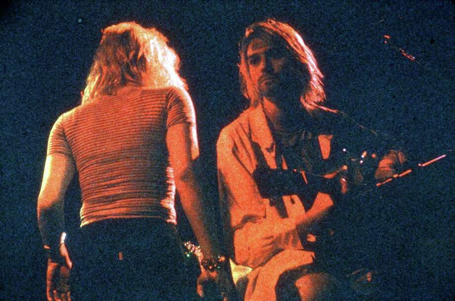 This undated photo - circa 1990 - shows Kurt Cobain performing with Nirvana and Courtney Love of Hole. The two married in 1992 and their daughter, Frances Bean Cobain, was born later that year. Photo: Lindsay Brice, Getty / Michael Ochs Archives
