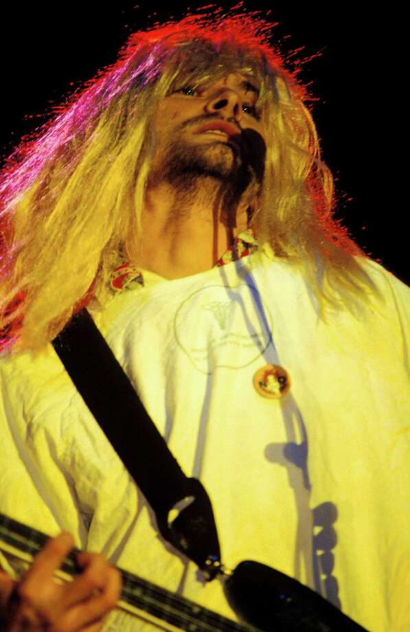 Kurt Cobain performing live onstage, wearing a wig at the Reading Festival in the United Kingdom Aug. 30, 1992. Photo: Mick Hutson, Getty / Redferns