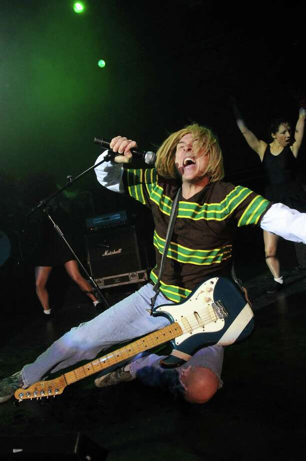 Of course, Nirvana's influence echoed throughout pop culture ever since Cobain's death. Here, 'Weird Al' Yankovic performs live on stage as Cobain  at The Kentish Town Forum on Dec. 6, 2010 in London. Photo: Jim Dyson, Getty / 2010 Jim Dyson