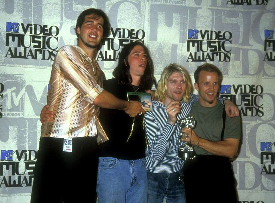 Krist Novoselic, Dave Grohl and Kurt Cobain of Nirvana and guest at the MTV Video Music Awards. Photo: Barry King, Getty / WireImage