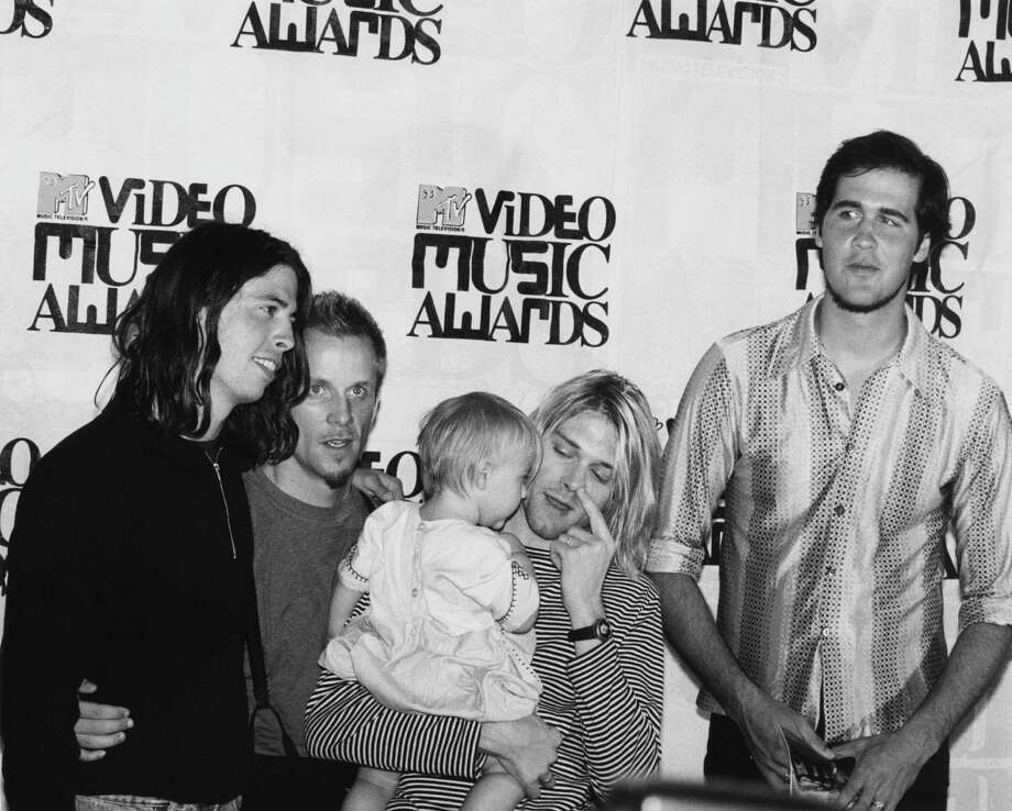 American rock group Nirvana at the MTV Video Awards, at the at the Gibson Amphitheatre, Los Angeles, 2nd September 1993. Left to right: drummer Dave Grohl, video director Kevin Kerslake, singer and guitarist Kurt Cobain (1967 - 1994), holding his daughter, Frances Bean Cobain, and bassist Krist Novoselik. The group won a 'moonman' for best alternative video, for 'In Bloom'. Photo: Getty