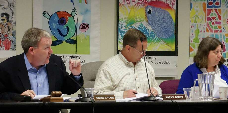 Board of Finance Chairman Thomass Flynn, Vice Chairman Jim Brown and Mary LeClerc discuss the proposed 201-15 municipal budget prior to Thursday night's vote. Photo: Genevieve Reilly / Fairfield Citizen