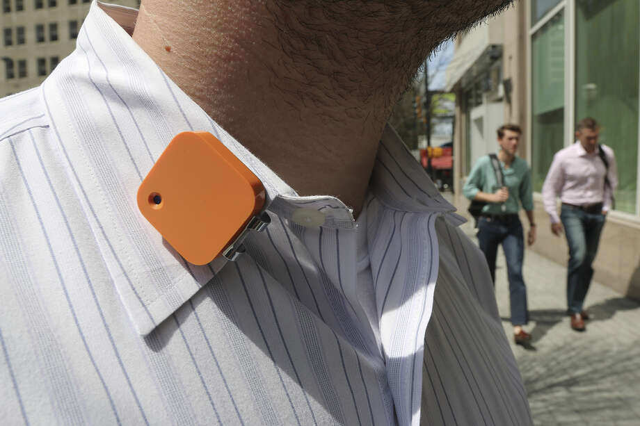 A Narrative Clip life-logging device is worn on a shirt collar Wednesday, April 2, 2014 in Atlanta. The small, wearable camera takes a photo automatically every 30 seconds. (AP Photo/Ron Harris) ORG XMIT: MER2014040216033031 Photo: Ron Harris / AP