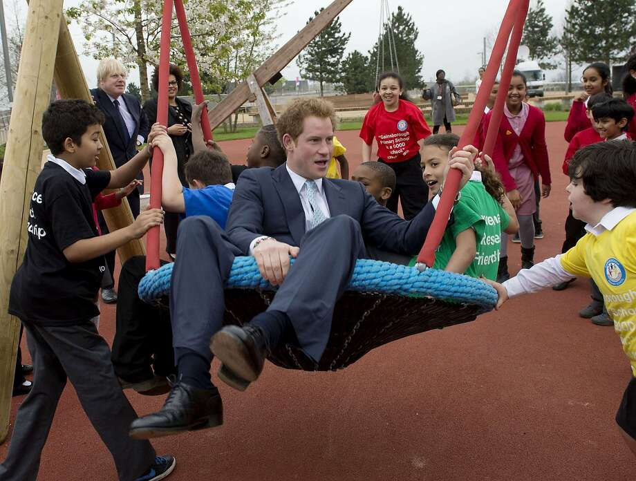 Wild about Harry:Britain's Prince Harry swings with local school   children at the new Queen Elizabeth Olympic Park in London. In back is Mayor of London   Boris Johnson. Photo: Chris Harris, AFP/Getty Images