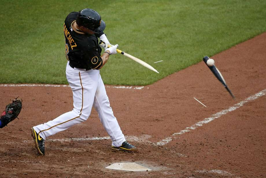 Unfortunate break:Tony Sanchez turns his bat into kindling during a Cubs-Pirates game in Pittsburgh. The ball popped up to Cubs reliever Pedro Strop, who caught it and threw 