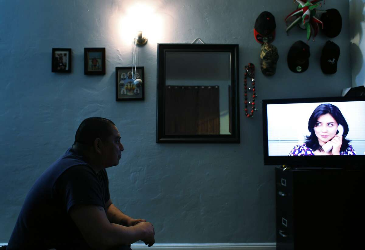 Raymundo Gutierrez watches a telenovela (spanish soap opera) on tv in his apartment on Wednesday, April 2, 2014, in San Francisco, Calif. Gutierrez works two minimum wage jobs to make ends meet in San Francisco, Calif., having to share his apartment with several family members who also work minimum wage jobs.