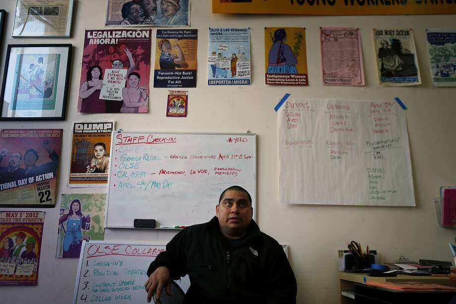 Raymundo Gutierrez at the Young Workers United office on Wednesday, April 2, 2014, in San Francisco, Calif., where he volunteers to help other workers seeking assistance.  Gutierrez works two minimum wage jobs to make ends meet in San Francisco, Calif., having to share his apartment with several family members who also work minimum wage jobs. Photo: Carlos Avila Gonzalez, The Chronicle