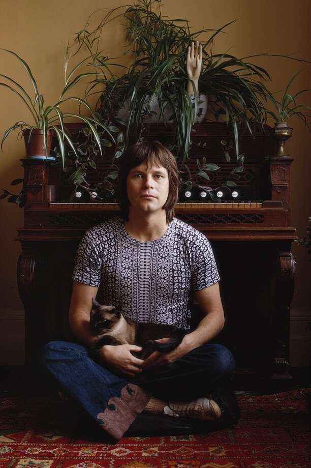 1972: Terry Gilliam, screenwriter, animator, director and 'Monty Python' actor, sitting with a cat. Photo: Tony Evans/Timelapse Library Ltd, Getty Images