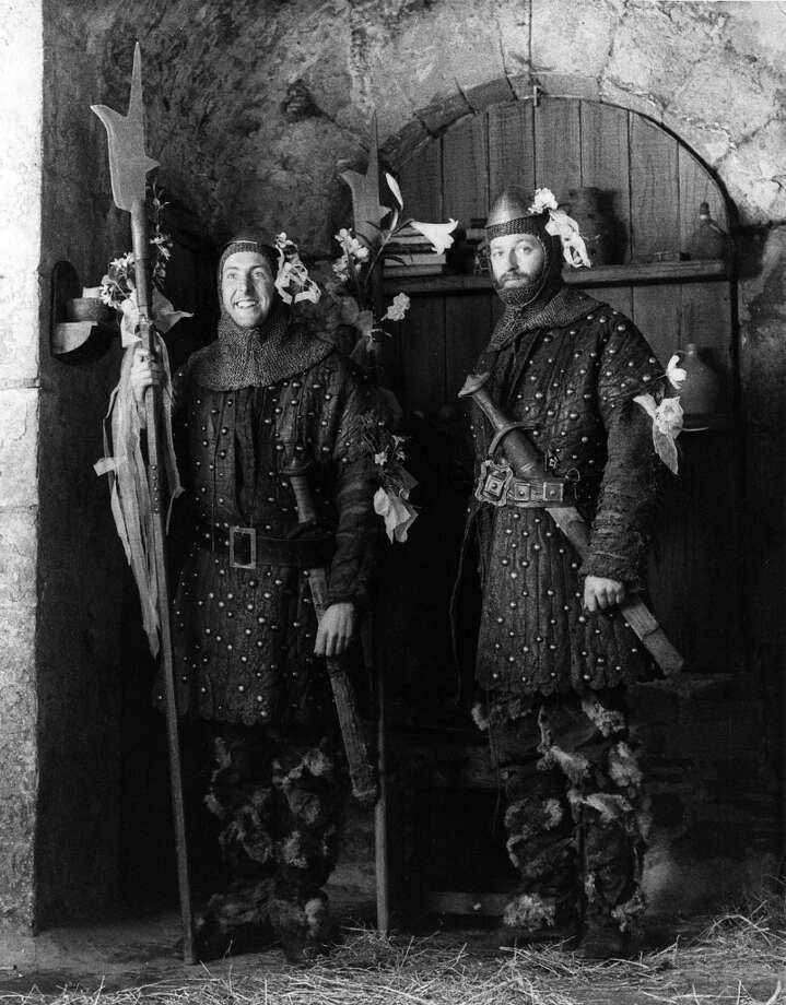 1974:  Two guards of Swamp Castle, Eric Idle and Graham Chapman as they appeared in the film, 'Monty Python and The Holy Grail'. Photo: Evening Standard, Getty Images