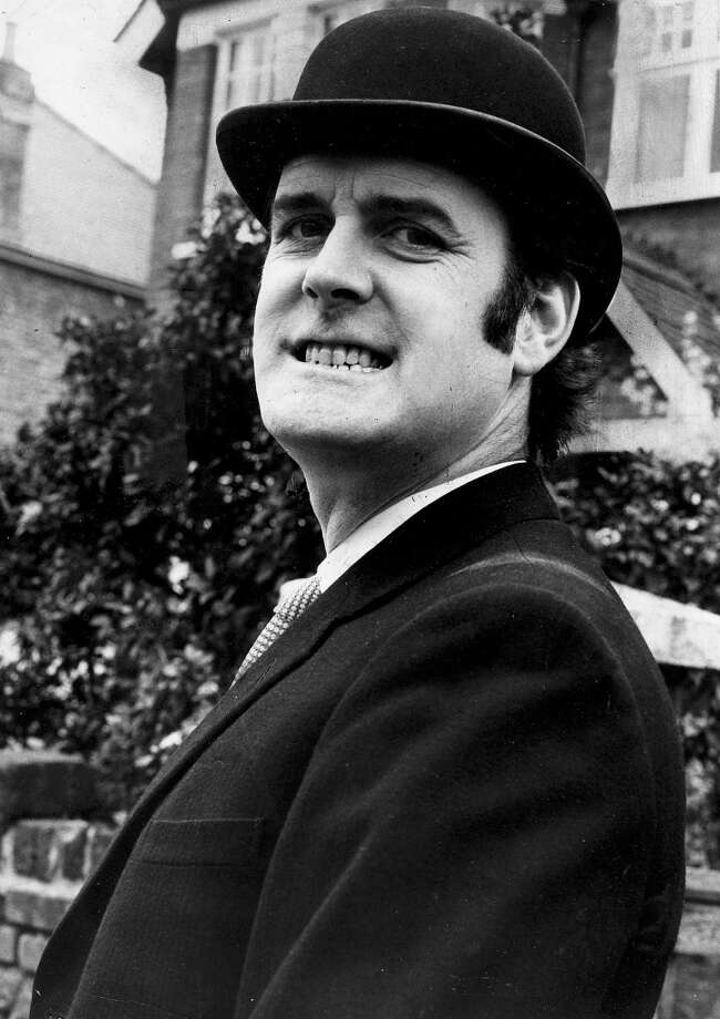 "1971: British born comedy actor John Cleese, one of the stars of the cult comedy TV, program of the 1970's ""Monty Python's Flying Circus"" in a sketch for one of the shows. Photo: Popperfoto, Popperfoto/Getty Images"
