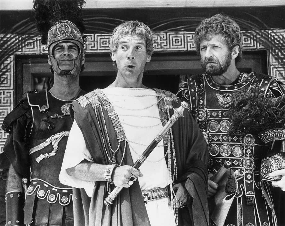 1979:  Members of the British comedy team, Monty Python, during the filming of their controversial film 'The Life of Brian', (from left) John Cleese as a centurion, Michael Palin as Pontius Pilate and Graham Chapman as Biggus Dickus. Photo: Evening Standard, Getty Images